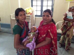 2 ladies holding baby