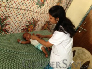 Baby receiving medical care